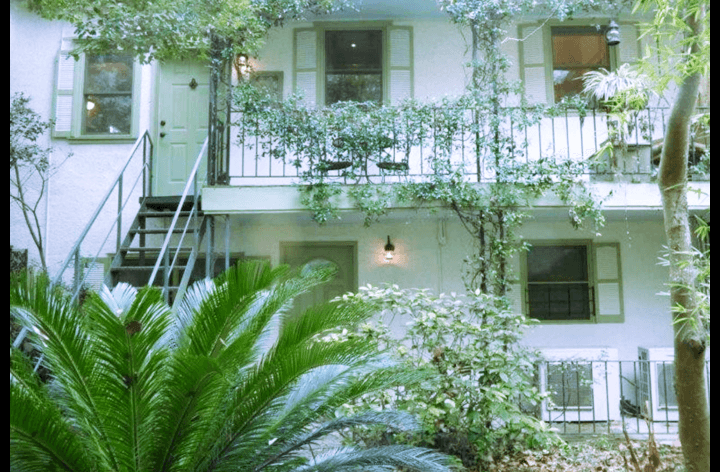 Entrance to the upper level carriage house is in this lush courtyard.