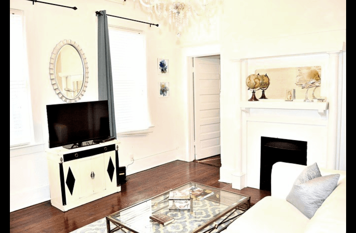 Front room with original fireplace and art deco decor.